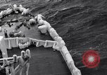 Image of Sailors chop ice from Japanese light cruiser Aleutians, 1942, second 47 stock footage video 65675031675