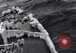Image of Sailors chop ice from Japanese light cruiser Aleutians, 1942, second 48 stock footage video 65675031675