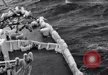 Image of Sailors chop ice from Japanese light cruiser Aleutians, 1942, second 49 stock footage video 65675031675