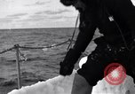 Image of Sailors chop ice from Japanese light cruiser Aleutians, 1942, second 51 stock footage video 65675031675