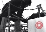 Image of Sailors chop ice from Japanese light cruiser Aleutians, 1942, second 57 stock footage video 65675031675