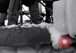 Image of Sailors chop ice from Japanese light cruiser Aleutians, 1942, second 59 stock footage video 65675031675