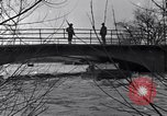 Image of Soldiers standing guard atop a bridge United States USA, 1943, second 37 stock footage video 65675031862