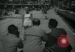 Image of 1930s tourists in swim suits West Palm Beach Florida USA, 1936, second 10 stock footage video 65675031920