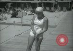 Image of 1930s tourists in swim suits West Palm Beach Florida USA, 1936, second 32 stock footage video 65675031920
