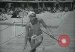 Image of 1930s tourists in swim suits West Palm Beach Florida USA, 1936, second 33 stock footage video 65675031920