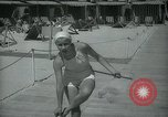 Image of 1930s tourists in swim suits West Palm Beach Florida USA, 1936, second 34 stock footage video 65675031920