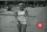Image of 1930s tourists in swim suits West Palm Beach Florida USA, 1936, second 35 stock footage video 65675031920
