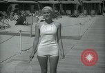 Image of 1930s tourists in swim suits West Palm Beach Florida USA, 1936, second 37 stock footage video 65675031920