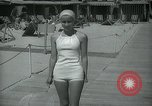 Image of 1930s tourists in swim suits West Palm Beach Florida USA, 1936, second 38 stock footage video 65675031920