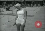 Image of 1930s tourists in swim suits West Palm Beach Florida USA, 1936, second 42 stock footage video 65675031920