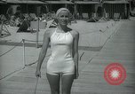 Image of 1930s tourists in swim suits West Palm Beach Florida USA, 1936, second 44 stock footage video 65675031920