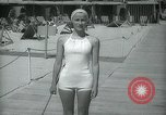 Image of 1930s tourists in swim suits West Palm Beach Florida USA, 1936, second 46 stock footage video 65675031920