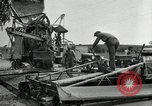 Image of Road construction United States USA, 1930, second 55 stock footage video 65675031956