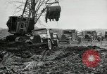 Image of road construction United States USA, 1930, second 24 stock footage video 65675031957