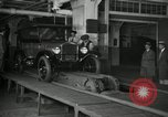 Image of Workers with Model T Fifteen Millionth car Highland Park Michigan USA, 1927, second 6 stock footage video 65675031962