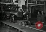 Image of Workers with Model T Fifteen Millionth car Highland Park Michigan USA, 1927, second 7 stock footage video 65675031962