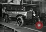 Image of Workers with Model T Fifteen Millionth car Highland Park Michigan USA, 1927, second 11 stock footage video 65675031962