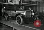 Image of Workers with Model T Fifteen Millionth car Highland Park Michigan USA, 1927, second 12 stock footage video 65675031962