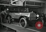 Image of Workers with Model T Fifteen Millionth car Highland Park Michigan USA, 1927, second 13 stock footage video 65675031962
