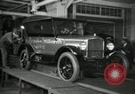 Image of Workers with Model T Fifteen Millionth car Highland Park Michigan USA, 1927, second 14 stock footage video 65675031962