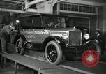 Image of Workers with Model T Fifteen Millionth car Highland Park Michigan USA, 1927, second 15 stock footage video 65675031962