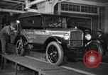 Image of Workers with Model T Fifteen Millionth car Highland Park Michigan USA, 1927, second 16 stock footage video 65675031962
