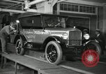 Image of Workers with Model T Fifteen Millionth car Highland Park Michigan USA, 1927, second 17 stock footage video 65675031962