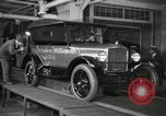 Image of Workers with Model T Fifteen Millionth car Highland Park Michigan USA, 1927, second 18 stock footage video 65675031962