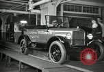 Image of Workers with Model T Fifteen Millionth car Highland Park Michigan USA, 1927, second 20 stock footage video 65675031962