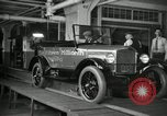 Image of Workers with Model T Fifteen Millionth car Highland Park Michigan USA, 1927, second 21 stock footage video 65675031962