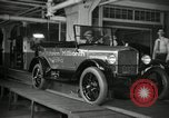 Image of Workers with Model T Fifteen Millionth car Highland Park Michigan USA, 1927, second 22 stock footage video 65675031962