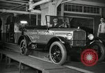 Image of Workers with Model T Fifteen Millionth car Highland Park Michigan USA, 1927, second 23 stock footage video 65675031962
