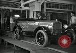 Image of Workers with Model T Fifteen Millionth car Highland Park Michigan USA, 1927, second 24 stock footage video 65675031962