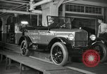 Image of Workers with Model T Fifteen Millionth car Highland Park Michigan USA, 1927, second 26 stock footage video 65675031962