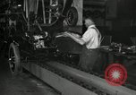 Image of Workers with Model T Fifteen Millionth car Highland Park Michigan USA, 1927, second 49 stock footage video 65675031962