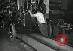 Image of Workers with Model T Fifteen Millionth car Highland Park Michigan USA, 1927, second 54 stock footage video 65675031962