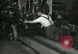 Image of Workers with Model T Fifteen Millionth car Highland Park Michigan USA, 1927, second 56 stock footage video 65675031962