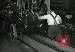 Image of Workers with Model T Fifteen Millionth car Highland Park Michigan USA, 1927, second 57 stock footage video 65675031962