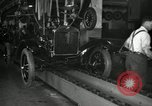 Image of Workers with Model T Fifteen Millionth car Highland Park Michigan USA, 1927, second 58 stock footage video 65675031962