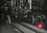 Image of Workers with Model T Fifteen Millionth car Highland Park Michigan USA, 1927, second 59 stock footage video 65675031962