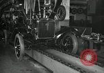 Image of Workers with Model T Fifteen Millionth car Highland Park Michigan USA, 1927, second 61 stock footage video 65675031962