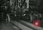 Image of Workers with Model T Fifteen Millionth car Highland Park Michigan USA, 1927, second 62 stock footage video 65675031962
