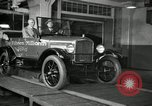 Image of Edsel Ford with Model T Fifteen Millionth car Highland Park Michigan USA, 1927, second 41 stock footage video 65675031963