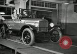 Image of Edsel Ford with Model T Fifteen Millionth car Highland Park Michigan USA, 1927, second 42 stock footage video 65675031963