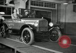 Image of Edsel Ford with Model T Fifteen Millionth car Highland Park Michigan USA, 1927, second 44 stock footage video 65675031963