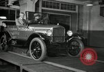 Image of Edsel Ford with Model T Fifteen Millionth car Highland Park Michigan USA, 1927, second 46 stock footage video 65675031963