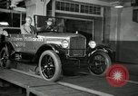 Image of Edsel Ford with Model T Fifteen Millionth car Highland Park Michigan USA, 1927, second 52 stock footage video 65675031963