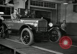 Image of Edsel Ford with Model T Fifteen Millionth car Highland Park Michigan USA, 1927, second 55 stock footage video 65675031963