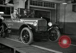 Image of Edsel Ford with Model T Fifteen Millionth car Highland Park Michigan USA, 1927, second 56 stock footage video 65675031963